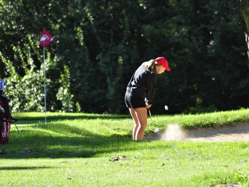 Lady Devils take team title at Naperville North golf invitational