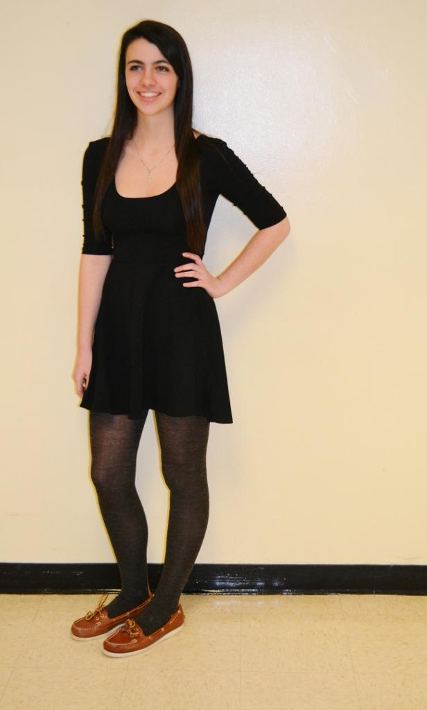 Nina Demirgian, junior, fashions a classic black skater skirt with tights and Sperrys. This fashion staple can be worn with practically anything and can be dressed up or down.