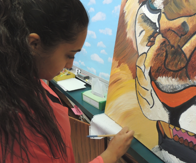 Painting inside the lions: Isaac uses art as creative outlet