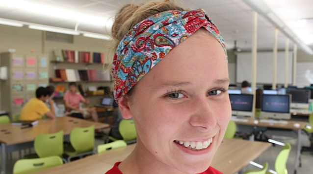 Haley Planson, senior, wears a patterned headband.