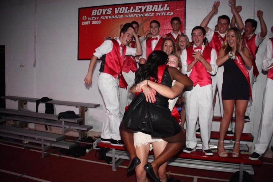 2014 Homecoming Queens Toni Adeyemi and Emma Day share a celebratory hug upon announcement of the tie.