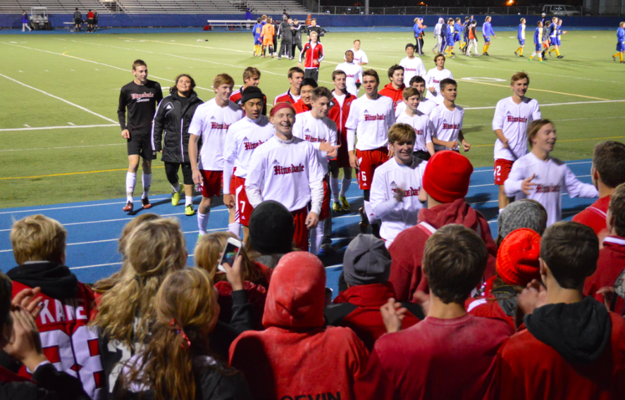 The boys' soccer team goes to meet the student section after beating LT in the sectional semifinal.