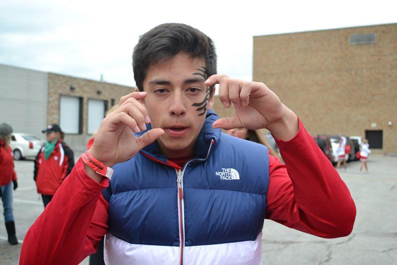 Steven Chun, senior, strikes a pose while showing his school spirit.
