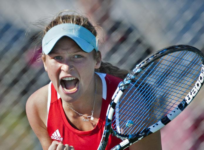 Bella Lorenzini, sophomore, celebrates during a match.