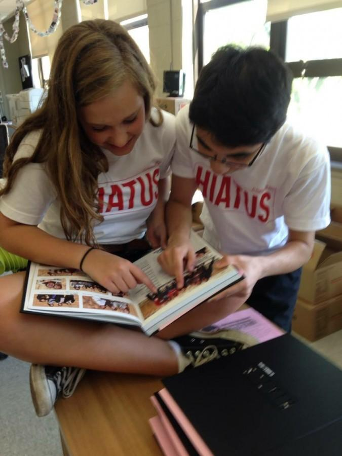 Suraj Marwaha and Julia Donnelly, both seniors and Editors-in-Chief of the yearbook, work hard on the 2014-2015 yearbook.