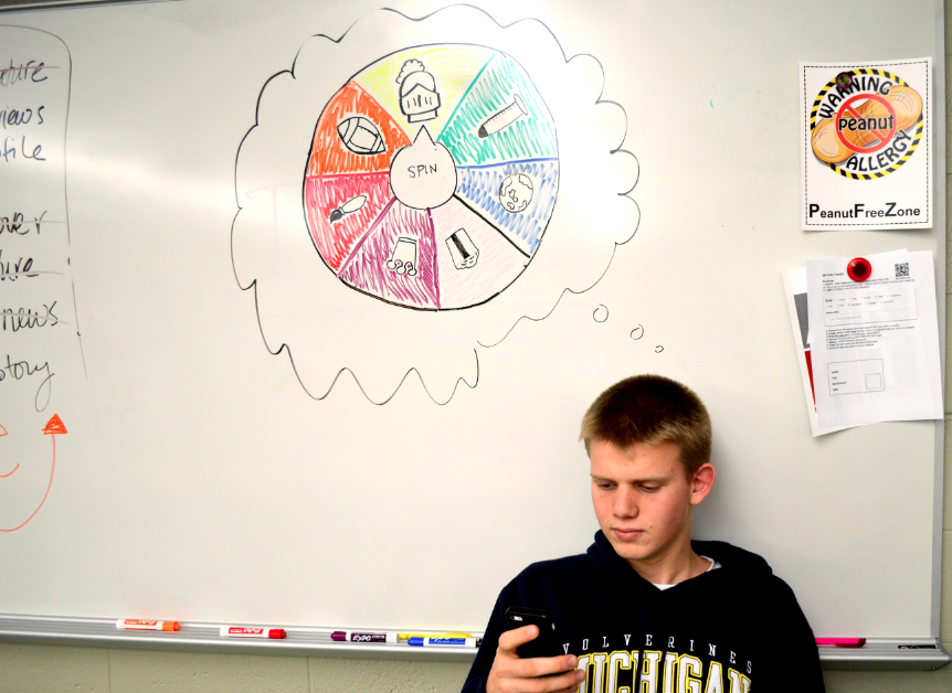 Michael Claussen, junior, plays Trivia Crack, an addicting app that has taken over Central.