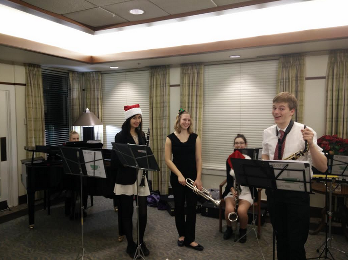 Students perform at Cordia Senior Residence for NHS hours. From left to right: Meg Hannigan, senior, Xena MaCarthee, senior, Laura Liberia, sophomore, Colleen Major, junior, and Jack Rasmussen, sophomore.