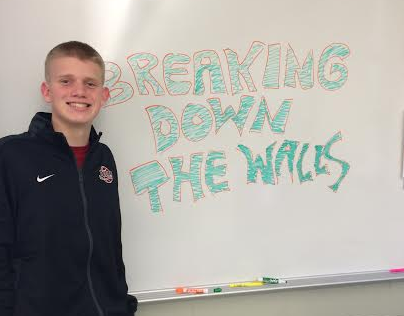 Michael Claussen, junior and co-president of Breaking Down the Walls White,  leads the club in its anti-bullying efforts.