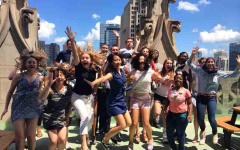Senior Riyah Basha, far right, leaps in delight with her fellow interns at the Chicago Tribune tower.