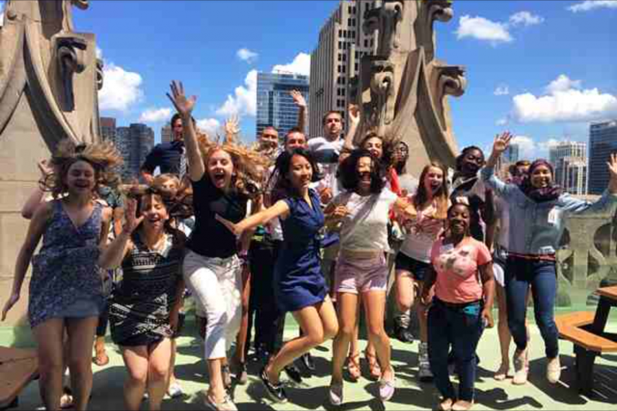 Senior+Riyah+Basha%2C+far+right%2C+leaps+in+delight+with+her+fellow+interns+at+the+Chicago+Tribune+tower.+