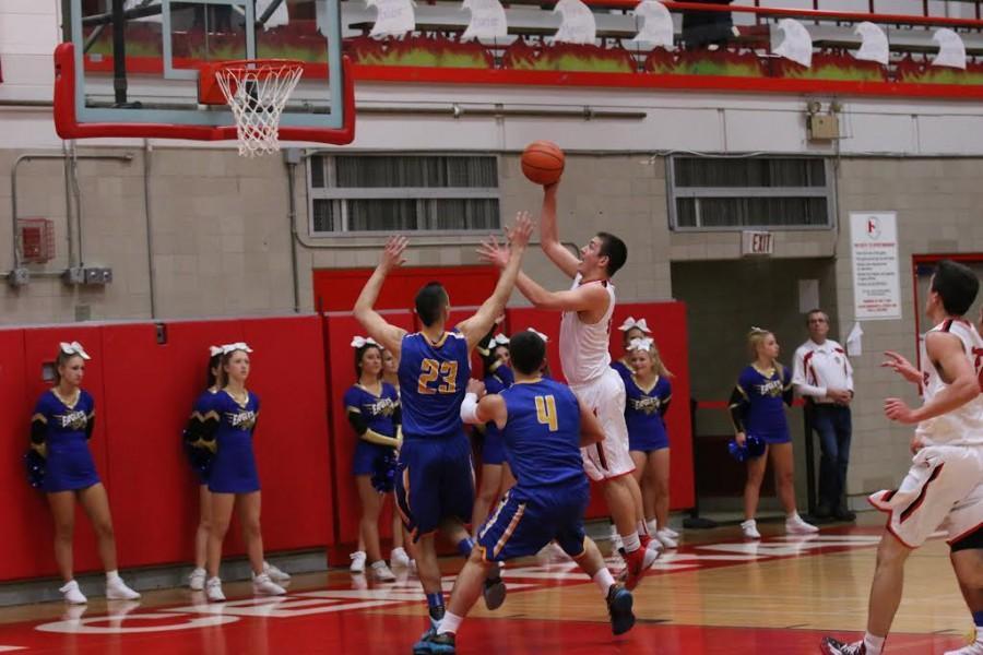 Grant+Hutcherson%2C+senior%2C+leaps+through+Stevenson%27s+defense+to+make+a+basket.