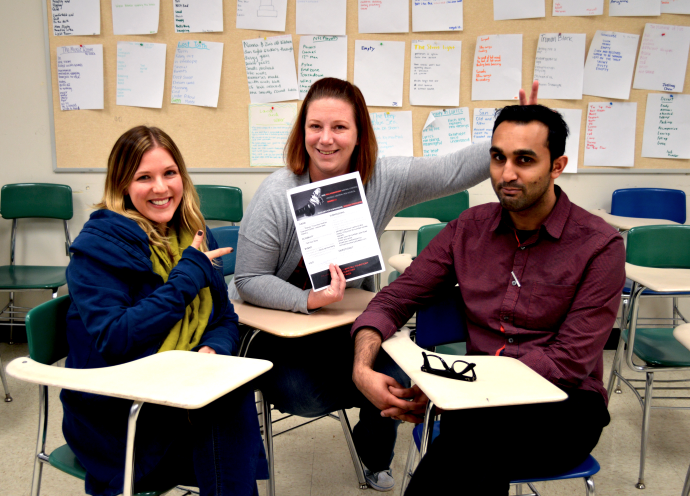 From Left: Mrs. Corelitz, Mrs. Saunders, and Mr. Bhatti pose with their writing competition's poster.