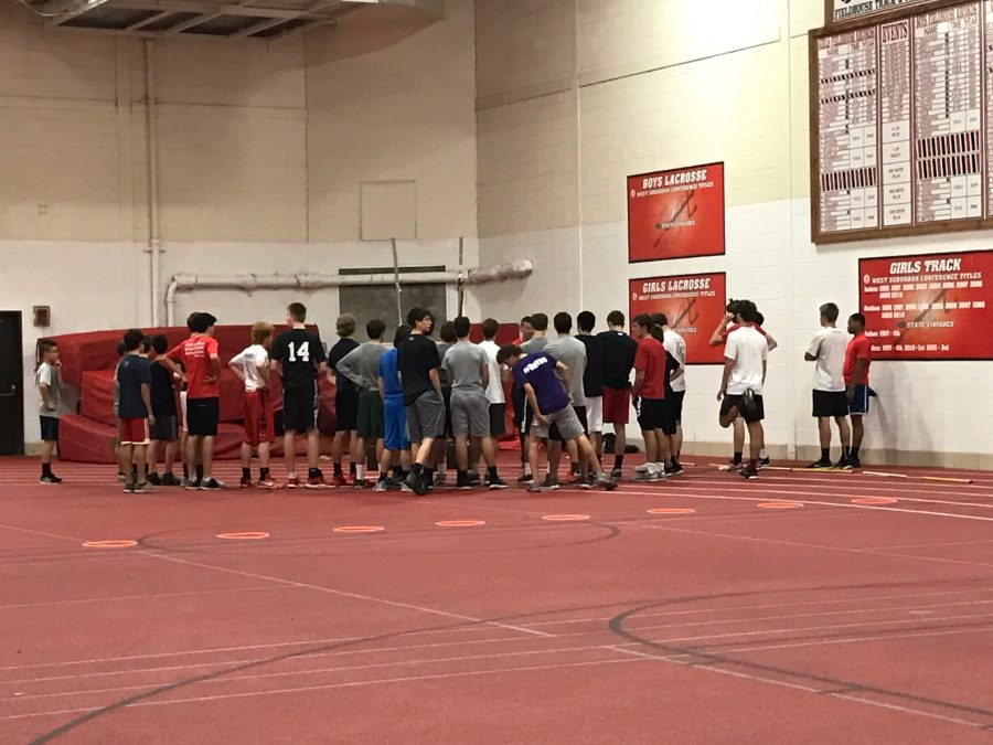 Boys basketball members warm up before their strength and conditioning session.