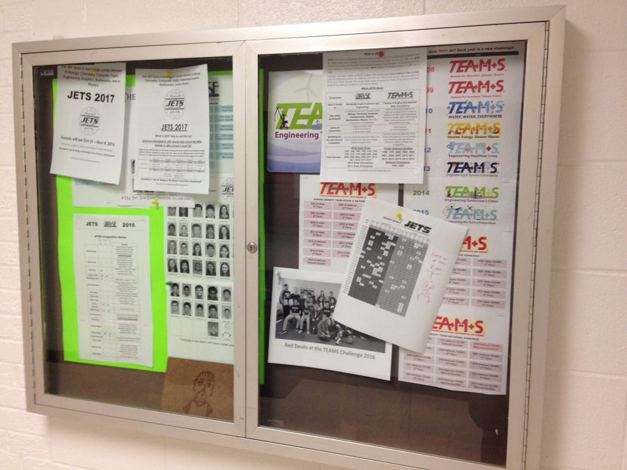 Posters+advertising+%22Jets+Club%22+posted+in+the+science+hallway.+