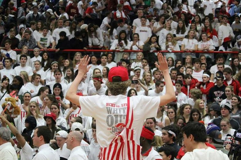 Berger directs the student section at the last home game against LT.