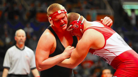 Hinsdale junior Matt Allen, left, wrestles Marist senior Jake Ford in the class 3A 285-pound championship match at State Farm Center. -Chicago Tribune