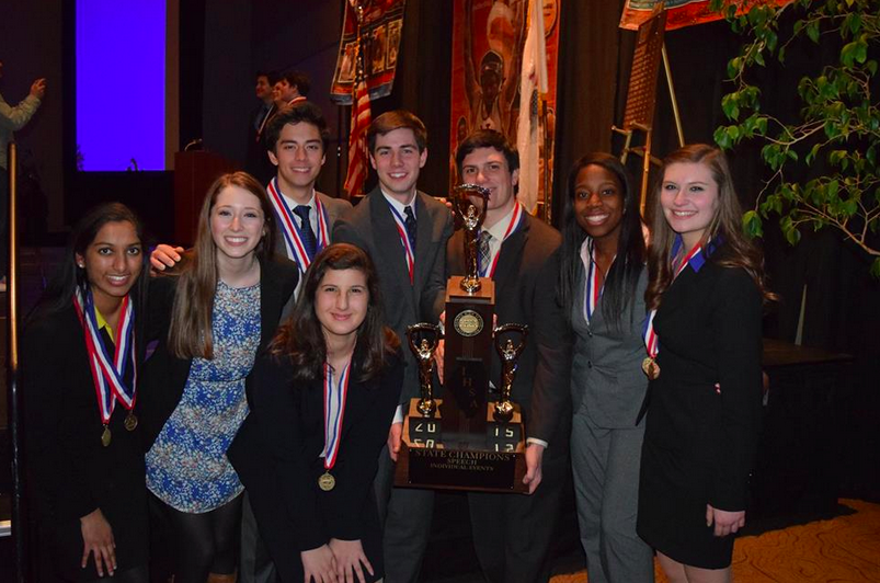 The seniors on the state Forensics team pose with their first place trophy. From left: Divya Surabhi, Libby Morris, Steven Chun, Christen Massouras, Jackson Dockery, Nick Giammanco, Toni Adeyemi, and Nicole Labun.