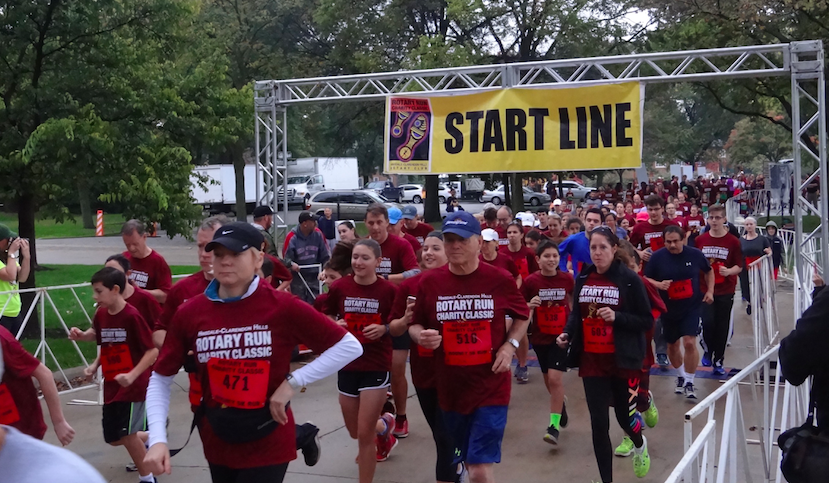 Runners start the 5 kilometer race. The race, hosted by The Community House, was held on Sunday, Oct. 16.