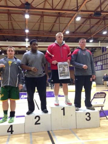 Matt Allen, junior, poses after winning the Sectional meet.