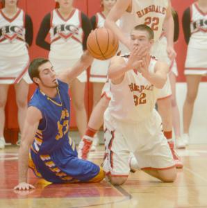 Matt Rafferty, senior, goes for basketball during rivalry game against Lyons Township.