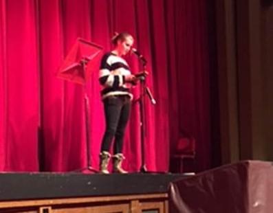 Elizabeth Storr, sophomore, recites poetry during the Poetry Slam.