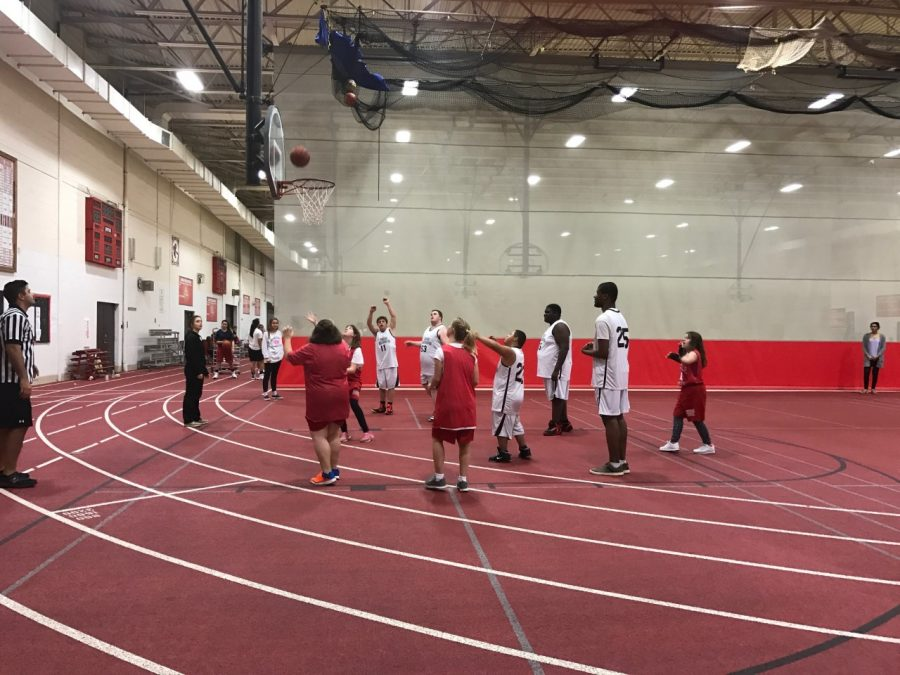 Hinsdale Centrals Special Olympics basketball team takes on the D99 Hoops team.