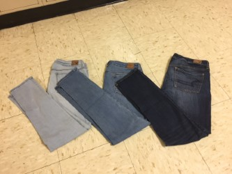 Denim blue jeans shown in order from lightest to darkest. Denim has become a favorite for students with the colder weather.