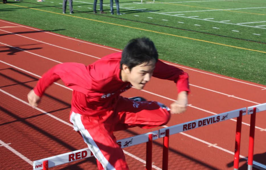 Shawn+Zhou%2C+junior%2C+trains+for+hurdles+during+track+and+field+practices+after+school.+