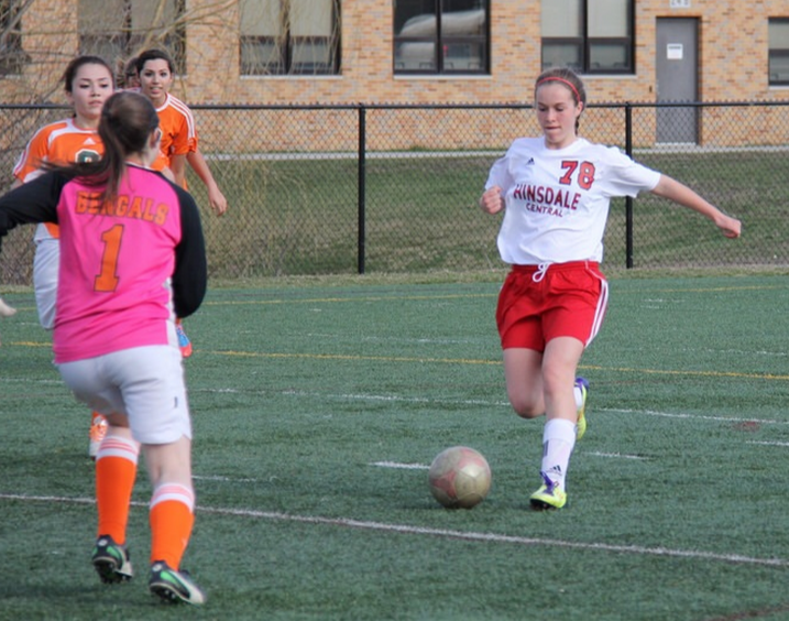 Sophomore Taylor Reinhardt prepares to kick a goal; Reinhardt has played soccer for 10 years and enjoys the sport.