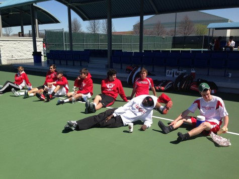 The boys Varsity tennis team watches their fellow teammates at Nationals.