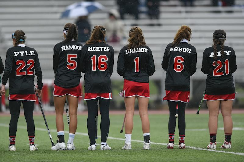 Members of the girls' lacrosse team await the beginning of a game. The team begins playoffs on May 18.