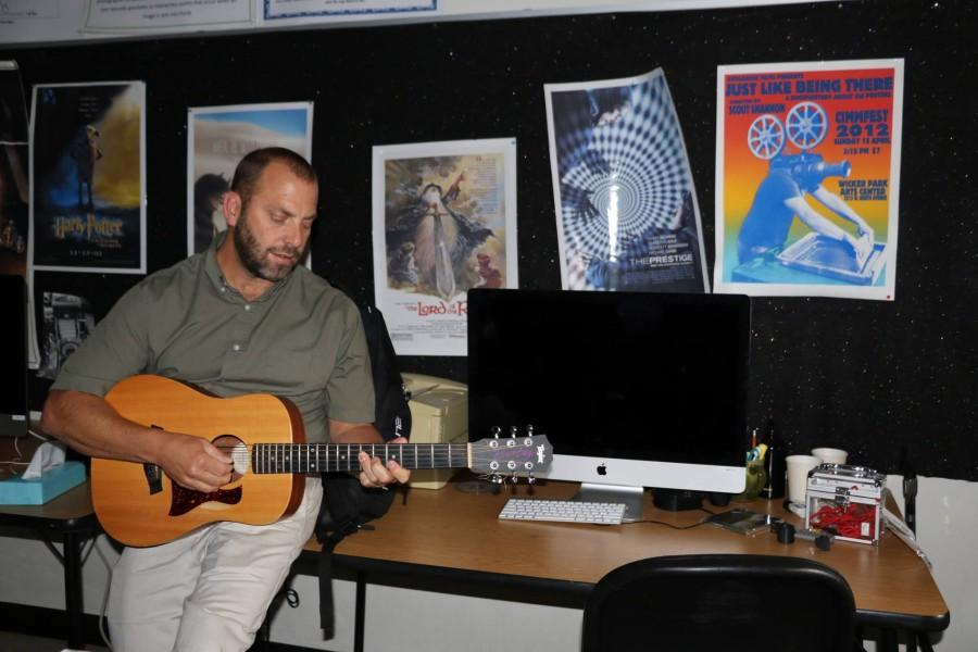 Mr. Russo plays guitar and sings one of his favorite songs
