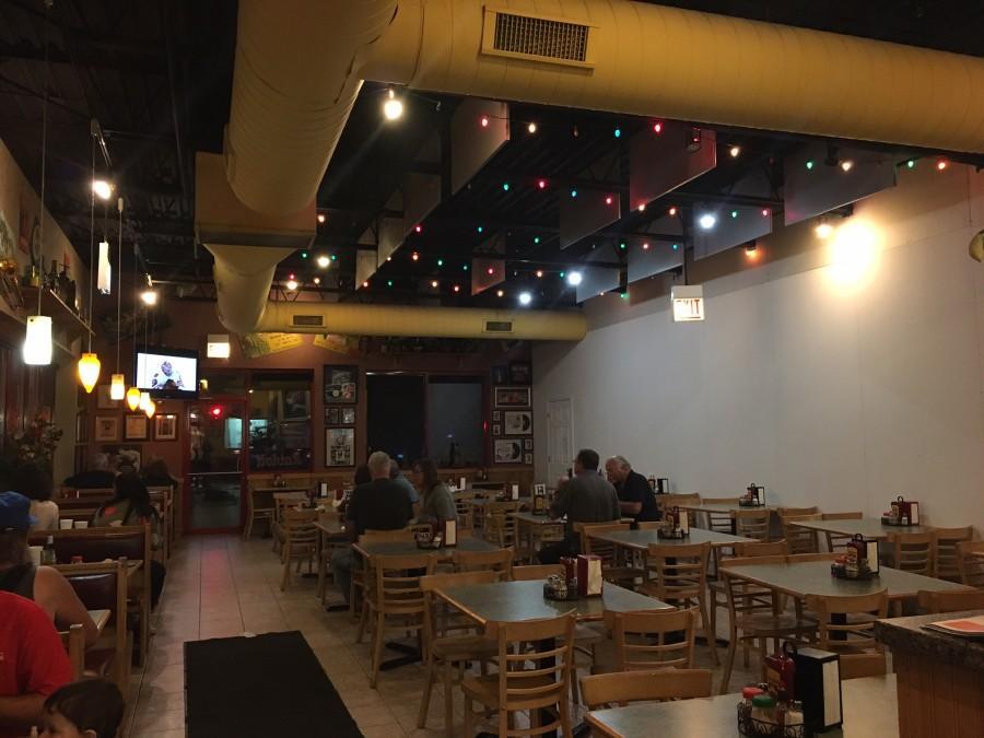 The inside of Falco's Pizza provides plentiful seating