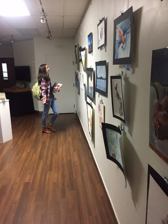 Junior Carolyn Chun made a point to visit the Homecoming Art Show to learn more about art projects.