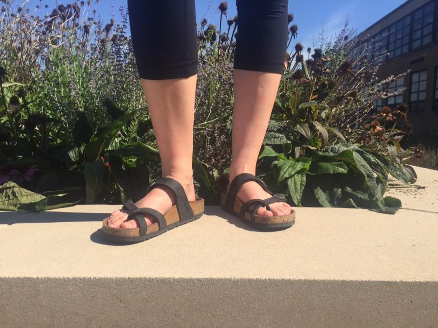 Abby Lee models her black mayari style birkenstocks.