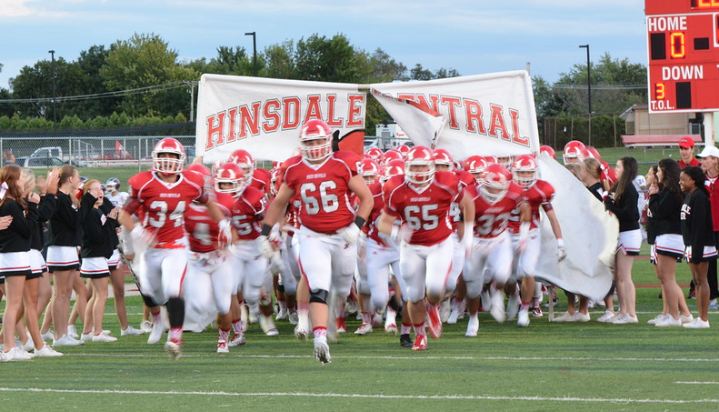 Hinsdale Central Varsity Football runs onto the field before their game against Downers Grove North on Sept. 11.