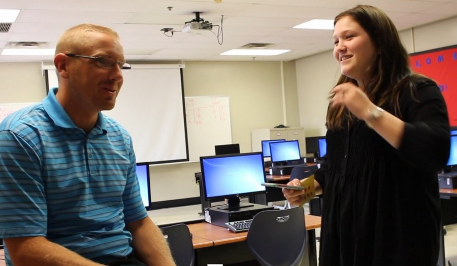 Staff writer Sophie Pecilunas challenges new teacher Mr. Madden, who teaches in the business department, on how well he knows the school fight song.