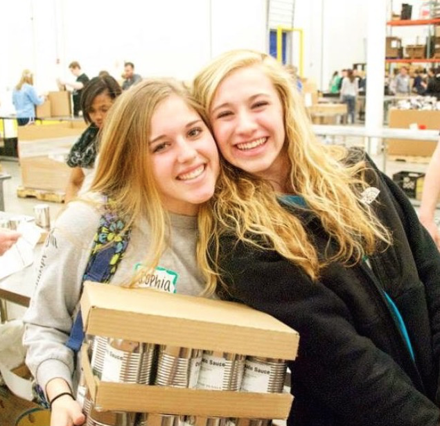 Ann Marie and Sophia Bernardi pose for a picture at the Northern Illinois Food Bank.