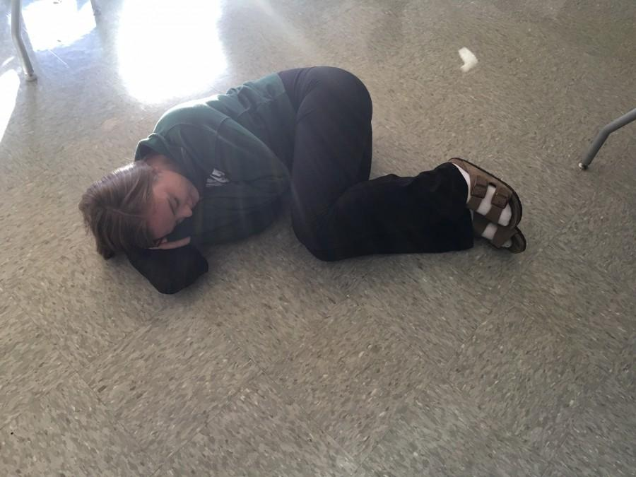 Junior Emily Tomkinson debates taking a nap on the floor, but fears what dreams she may endure. Libby McCarthy and Zach Wols analyze some strange nightmares from students.