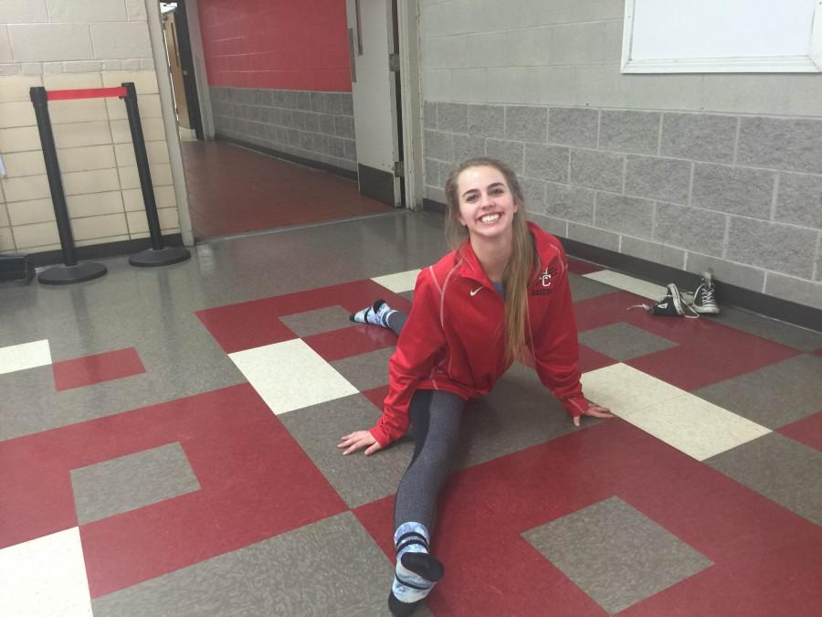 Senior Lily Eck sometimes practices routines during breaks in her study hall. She is on varsity cheerleading.