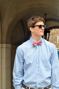 This boy models a semi-casual outfit with khakis, a dress shirt, and bowtie