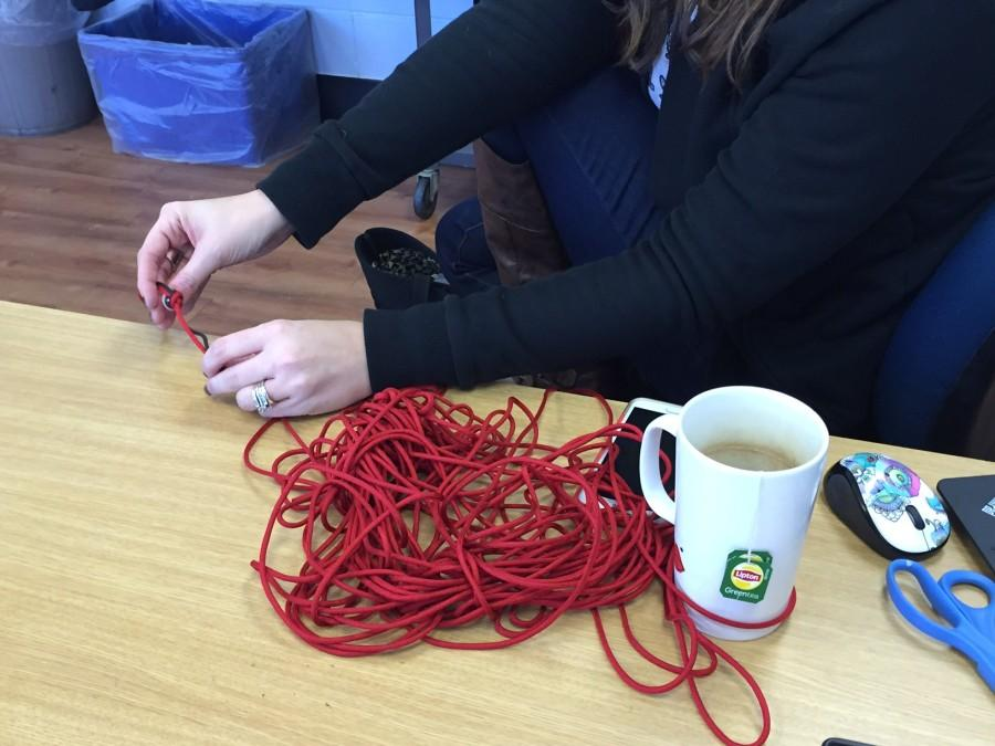 Mrs. Chandler ties knots in preparation for the storytelling event today in the community room at 5 p.m.