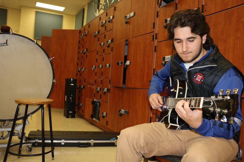 During+AP+Music+Theory%2C+Sammy+Dussias+relaxes+in+the+corner+and+practices+his+craft.+