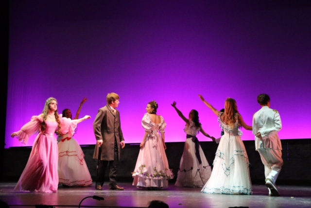 Junior Jack Rasmussen and senior Shannon Johnson are surrounded by the dancers during the show's rehearsal.