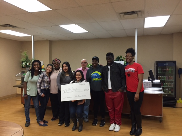 Black History Month student committee presented the check to Mr. Fleisher in order to benefit a school in need of musical instruments.