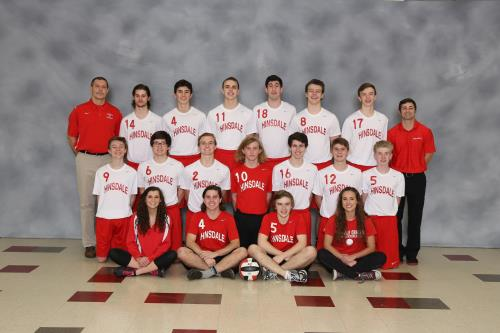 The boys' varsity volleyball team poses for a team picture.