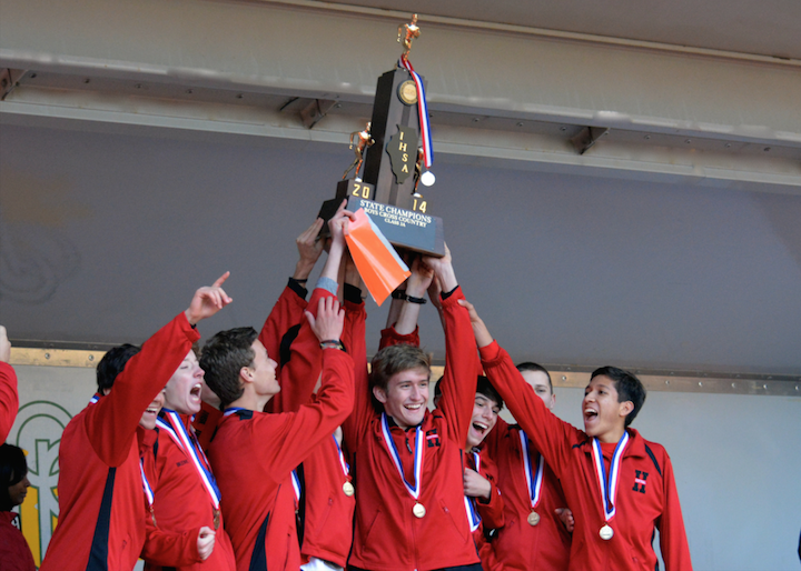 Hinsdale+Central+Cross+Country+runners+holding+a+state+title+trophy+from+2014.+The+team+will+look+to+hold+that+trophy+again+this+upcoming+season.+