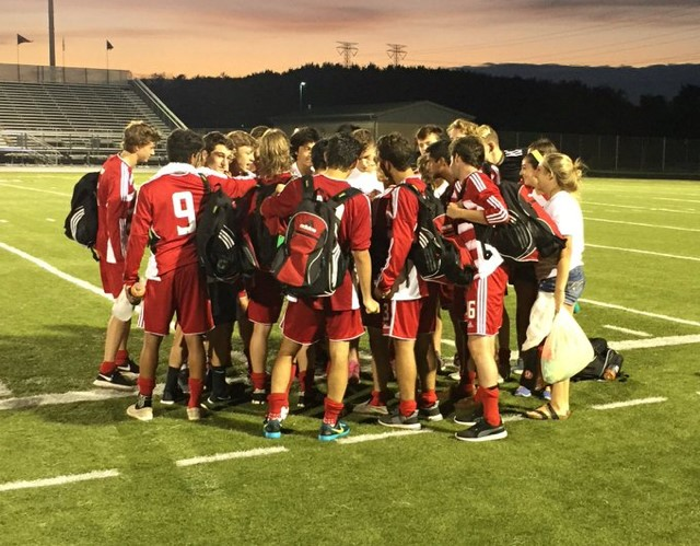 Boys+Varsity+Soccer+huddles+up+before+their+game+against+Metea+Valley+on+Aug.+25.