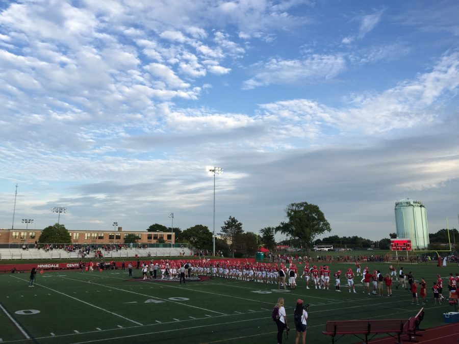 The Central football team stands for the U.S. National Anthem, a symbol that is now receiving attention due to recent protests where professional athletes have chosen to not stand during the anthem.