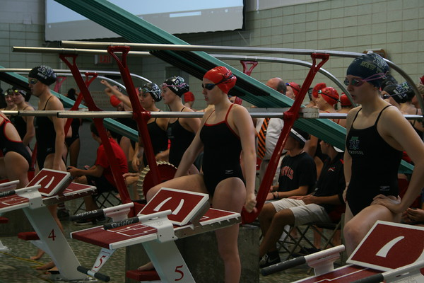 Kiernen Lynch, sophomore, gets ready to swim the 100 freestyle at a meet against New Trier.